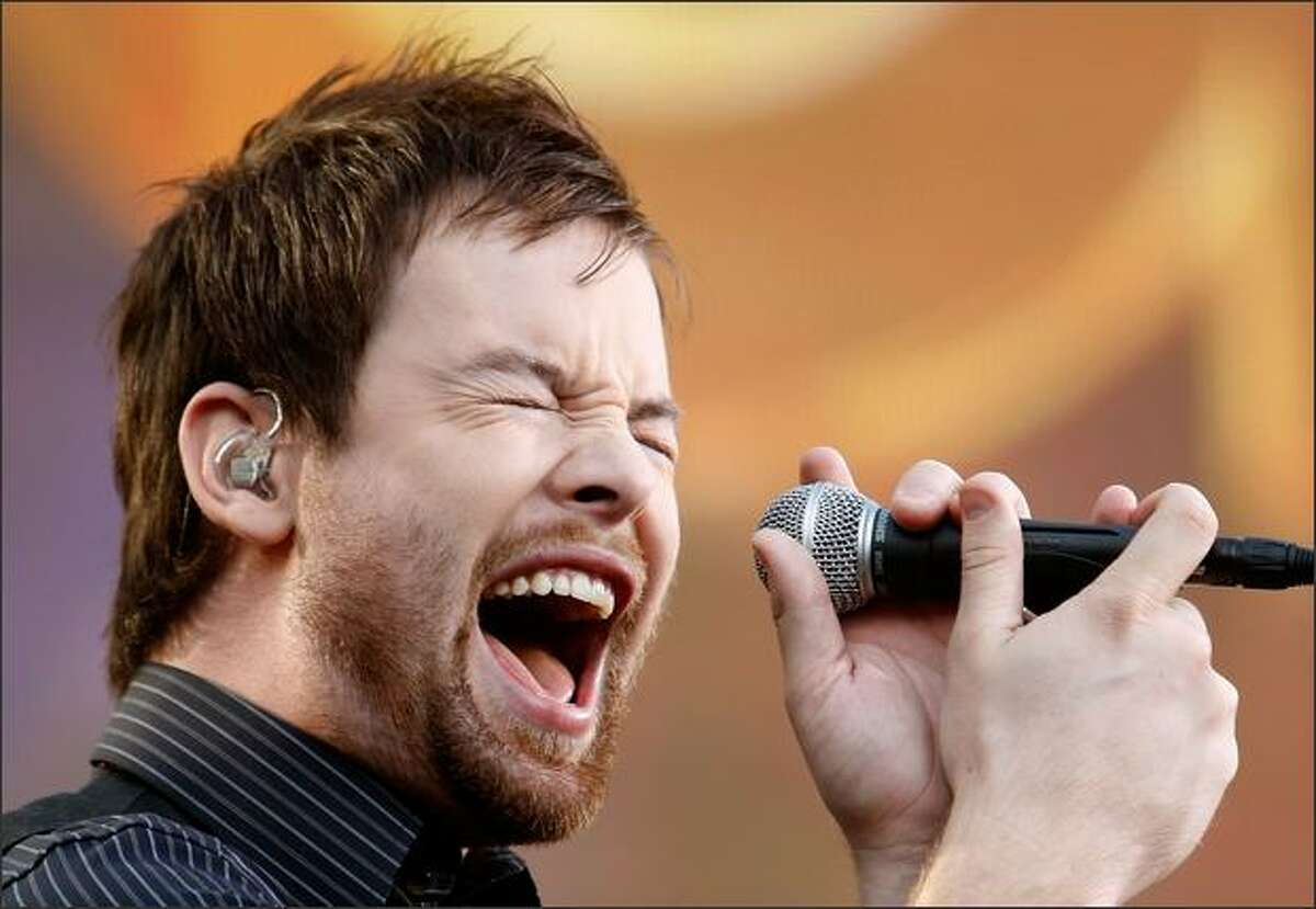 Singer David Cook performs during a Pre-Show at the 2008 American Music Awards held at Nokia Theatre L.A. on Sunday in Los Angeles.