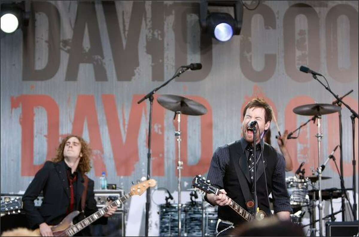 Singer David Cook, right, performs during a Pre-Show at the 2008 American Music Awards held at Nokia Theatre L.A. on Sunday in Los Angeles.