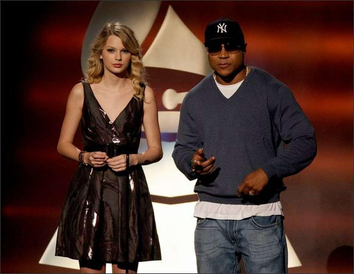 Hosts Taylor Swift (left) and LL Cool J speak onstage.