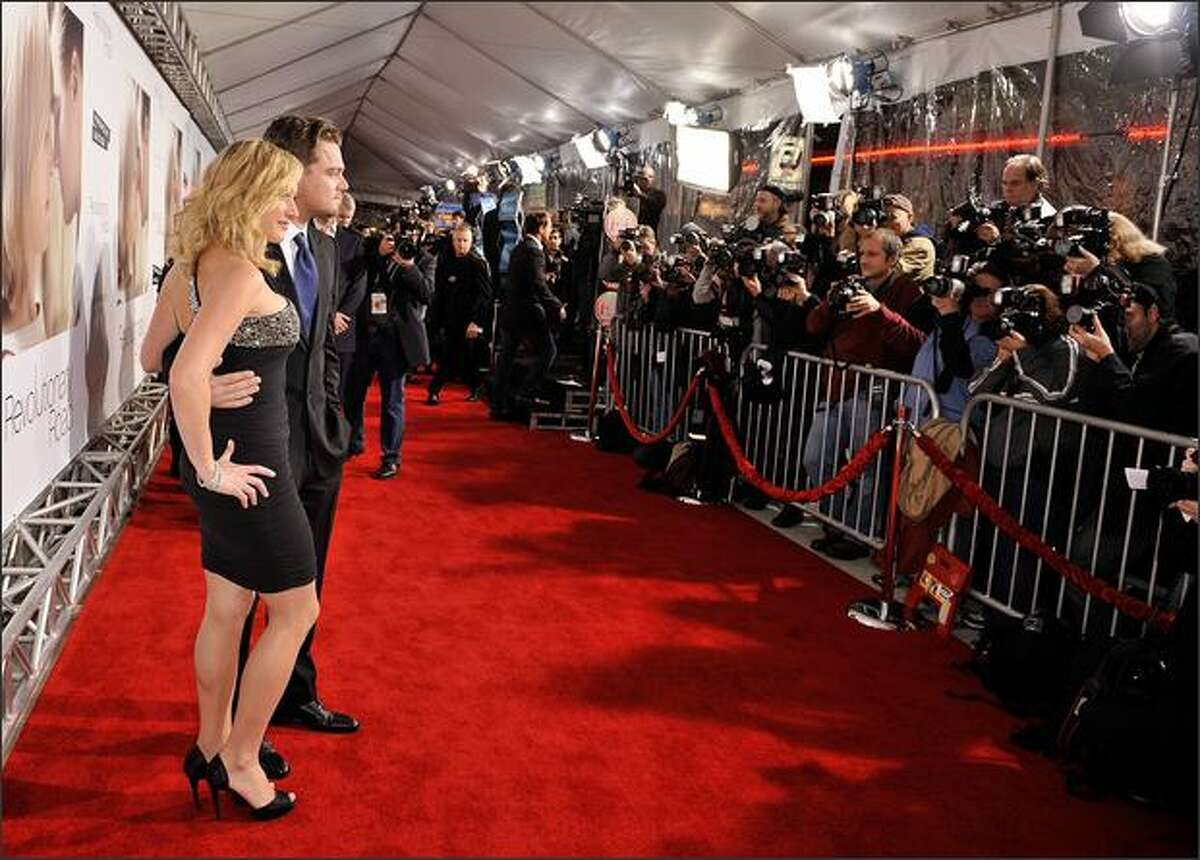 Actress Kate Winslet (L) and actor Leonardo DiCaprio arrive at Paramount Vantage's Los Angeles premiere of