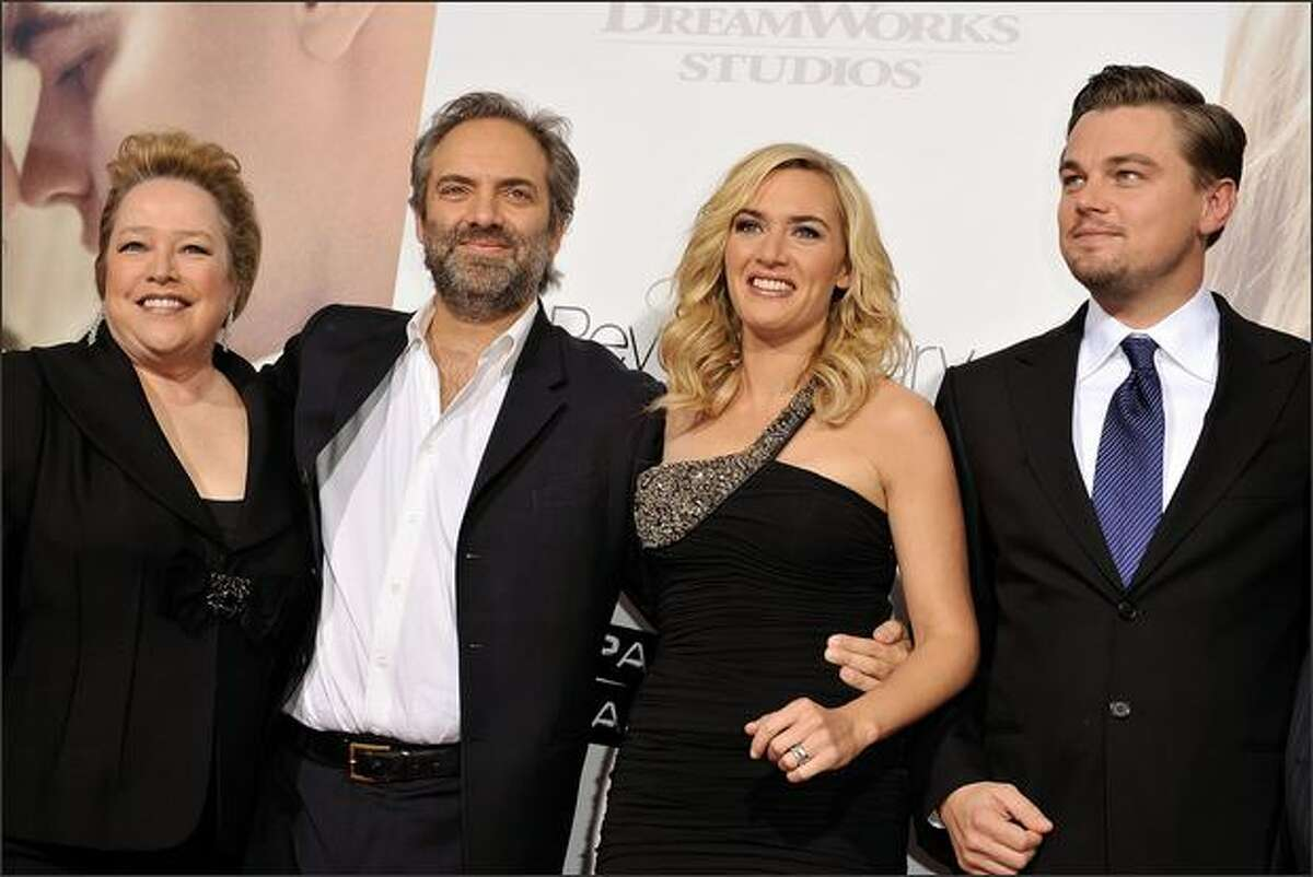 (L-R) Actress Kathy Bates, director Sam Mendes, actress Kate Winslet, and actor Leonardo DiCaprio arrive at Paramount Vantage's Los Angeles premiere of
