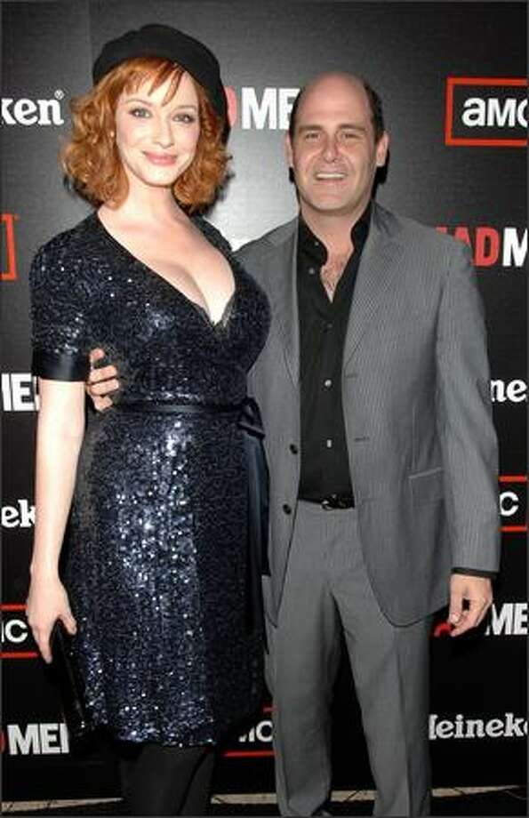 "Actor Christina Hendricks (L) and producer Matthew Weiner attend AMC & Heineken's ""Mad Men"" second season wrap party at Cicada on Saturday in Los Angeles, Calif. Photo: Getty Images"