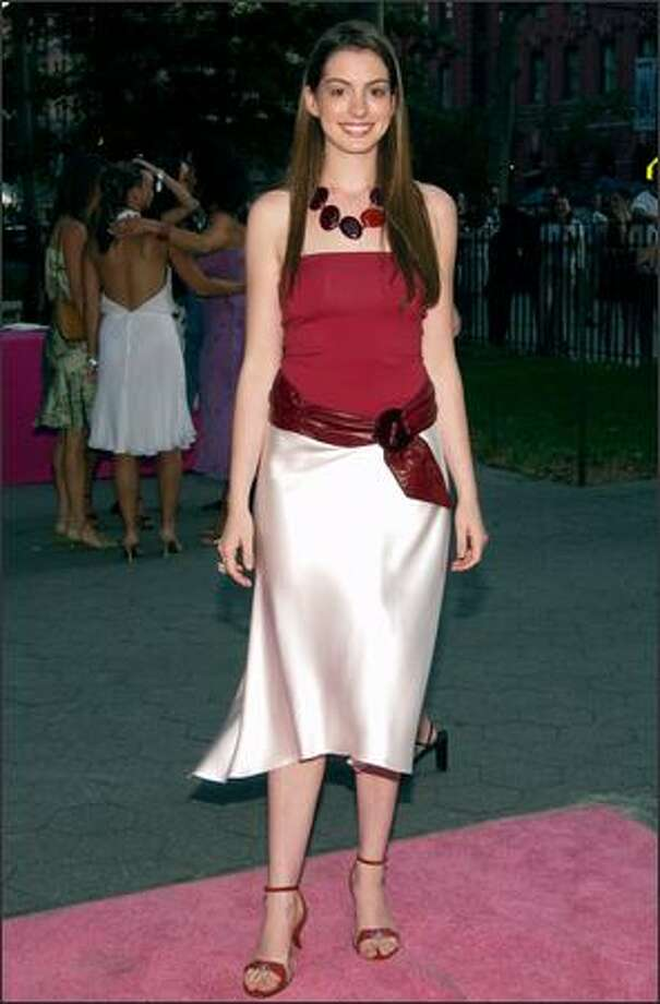 "Anne Hathaway arrives at the world premiere of the fifth season of HBO's ""Sex and the City"" at the American Museum of Natural History in New York, July 16, 2002. Photo: Getty Images"