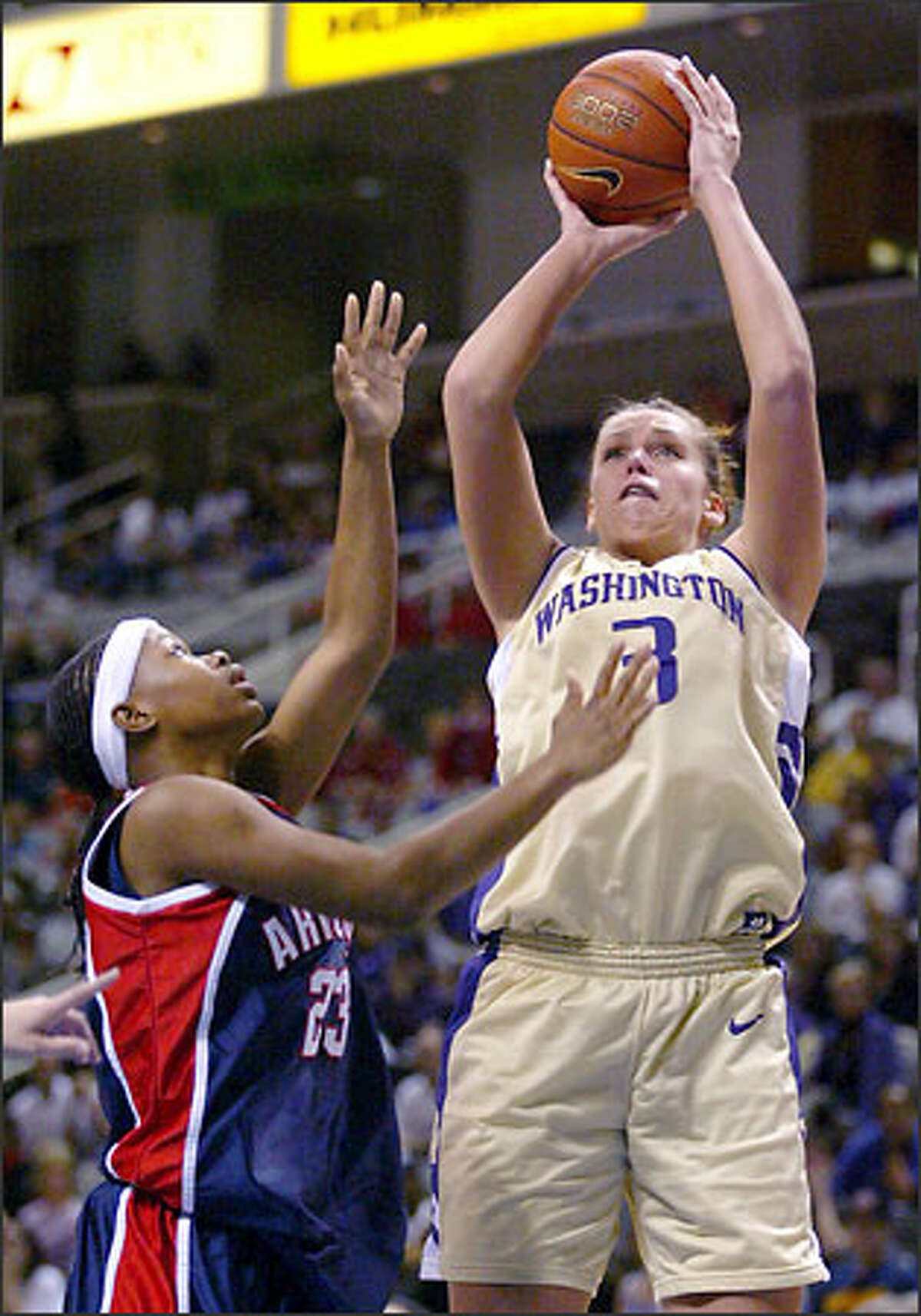 Washington's Andrea Lalum, right, shoots over Arizona's Natalie Jones, left, in the first half of the semifinals of the Pacific 10 Conference Championships in San Jose, Calif., Sunday, March 9, 2003.
