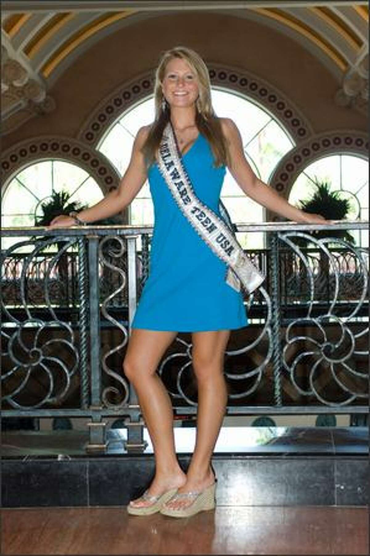 Bethany Brindley, Miss Delaware, arrives in the Royal Tower lobby at Atlantis on Tuesday.