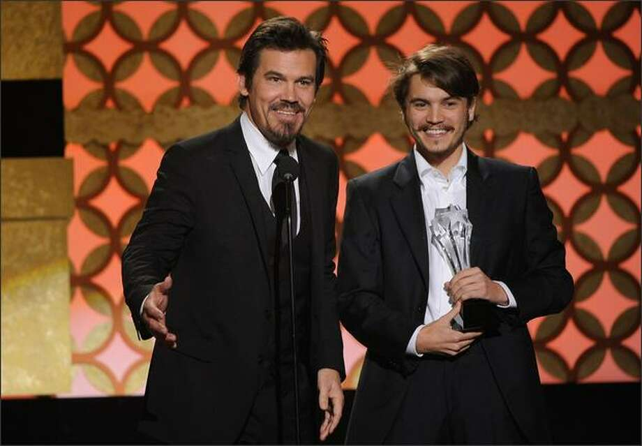 "Actors Josh Brolin (left) and Emile Hirsch accept the Best Acting Ensemble award for ""Milk."" Photo: Getty Images"