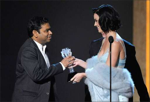 "Singer Katy Perry (right) presents composer A.R. Rahman the Best Composer award for his work on ""Slumdog Millionaire."" Photo: Getty Images"
