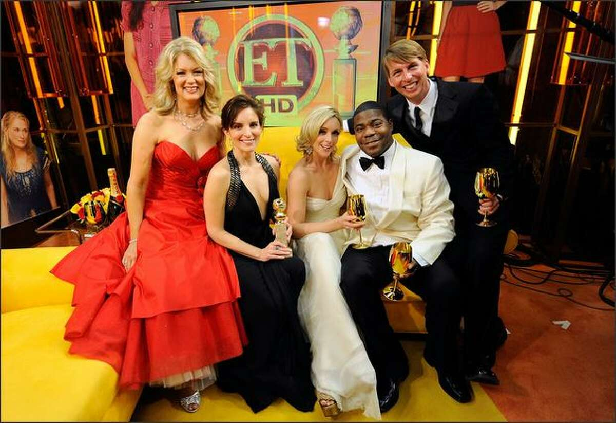 (L-R) Mary Hart poses with actors Tina Fey, Jane Krakowski, Tracy Morgan, and Jack McBrayer backstage with Entertainment Tonight at the 66th Annual Golden Globe Awards held at the Beverly Hilton Hotel in Beverly Hills, California.