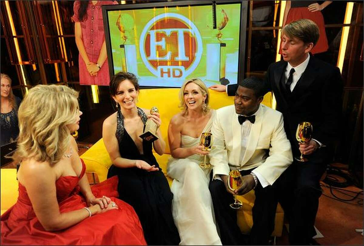 (L-R) Mary Hart speaks with actors Tina Fey, Jane Krakowski, Tracy Morgan, and Jack McBrayer backstage with Entertainment Tonight at the 66th Annual Golden Globe Awards held at the Beverly Hilton Hotel in Beverly Hills, California.