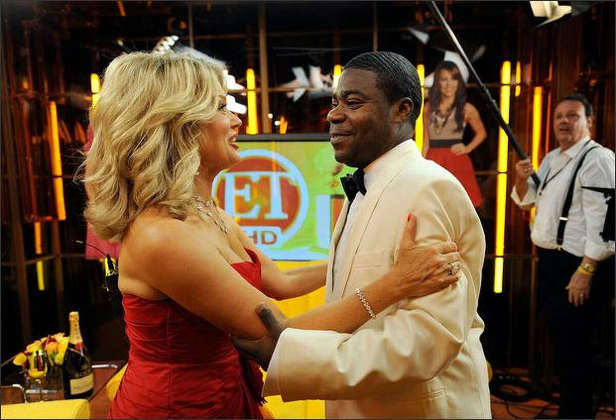 (L-R) Mary Hart speaks with actor Tracy Morgan backstage with Entertainment Tonight at the 66th Annual Golden Globe Awards held at the Beverly Hilton Hotel in Beverly Hills, California.