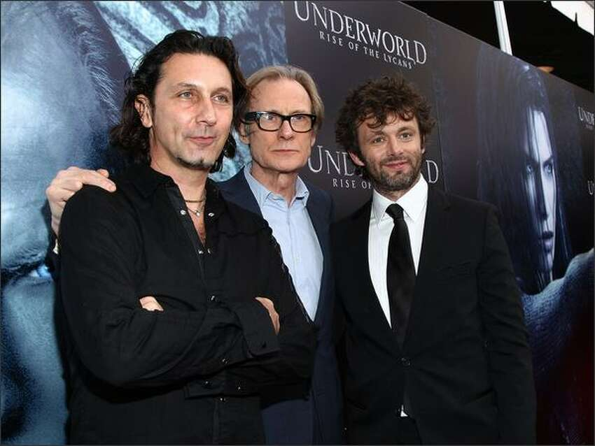 Director Patrick Tatopoulos, actor Bill Nighy and actor Michael Sheen arrive at the premiere of Screen Gem's