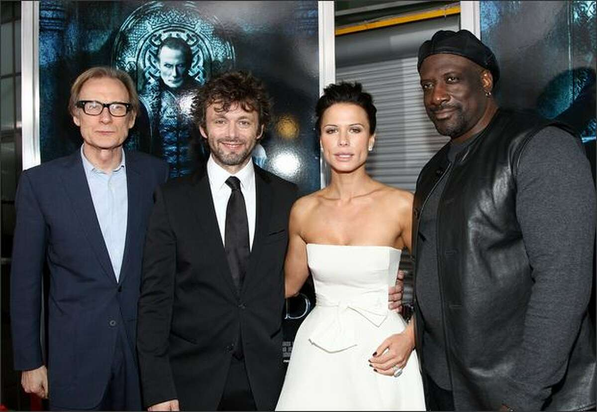 """Actor Bill Nighy, actor Michael Sheen, actress Rhona Mitra and actor Kevin Grevioux arrive at the premiere of Screen Gem's """"Underworld: Rise of the Lycans"""" held at the Arclight Theaters on Thursday in Los Angeles, Calif."""