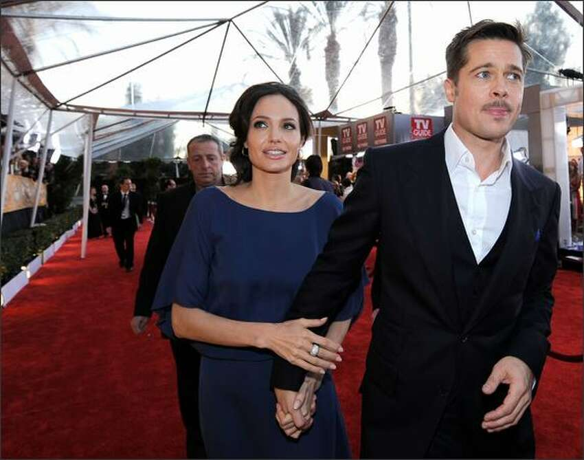 Actors Angelina Jolie and Brad Pitt arrive at the 15th Annual Screen Actors Guild Awards held at the Shrine Auditorium on Sunday in Los Angeles, California.