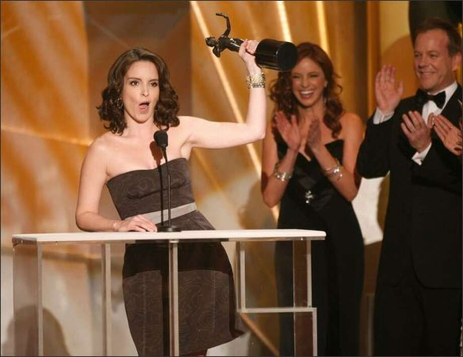 "Actress Tina Fey accepts the Female Actor in a Comedy Series award for ""30 Rock"" during the 15th Annual Screen Actors Guild Awards the Shrine Auditorium on Sunday in Los Angeles, California. Photo: Getty Images"