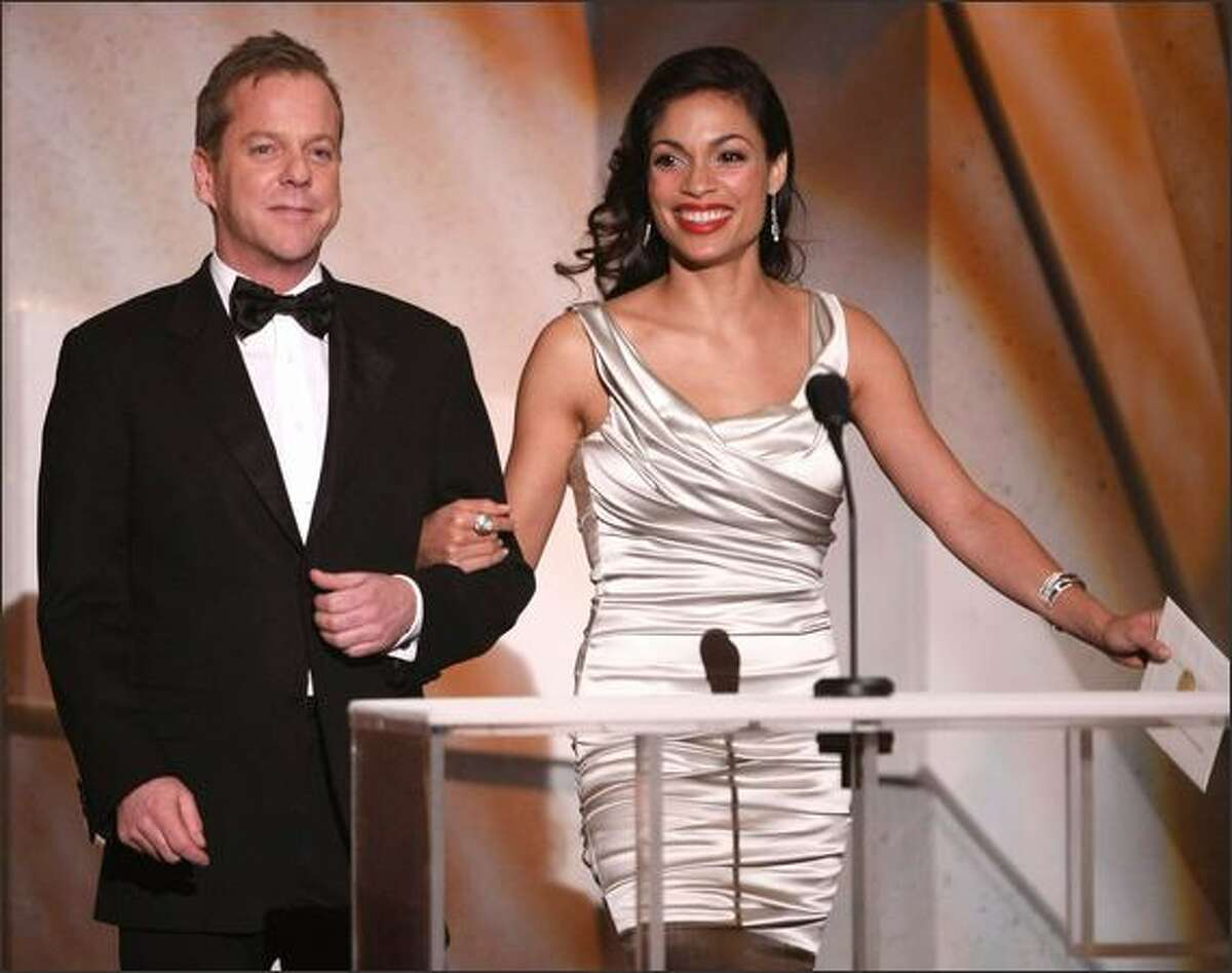 Presenters Kiefer Sutherland and Rosario Dawson speak onstage during the 15th Annual Screen Actors Guild Awards the Shrine Auditorium on Sunday in Los Angeles, California.