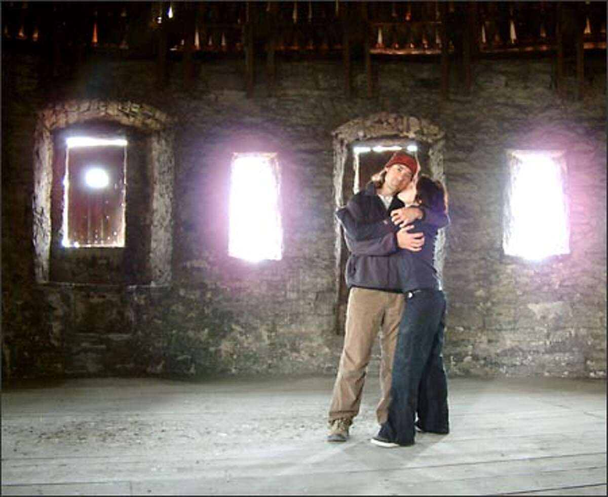 Richie Costleigh and Winda Benedetti do some smooching in a medieval watchtower in the heart of Tallinn, Estonia.