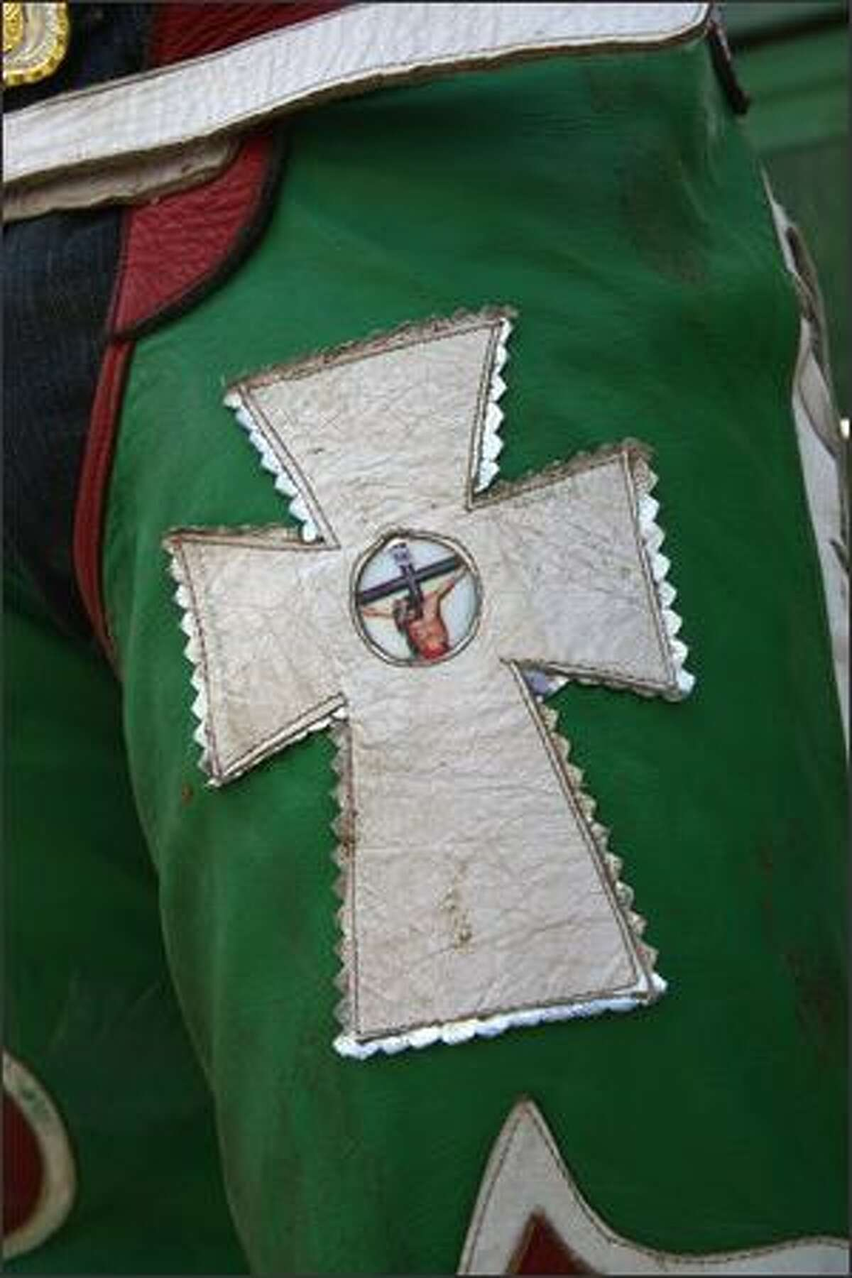 An image representing Jesus Christ on the cross adorns a pair of chaps.