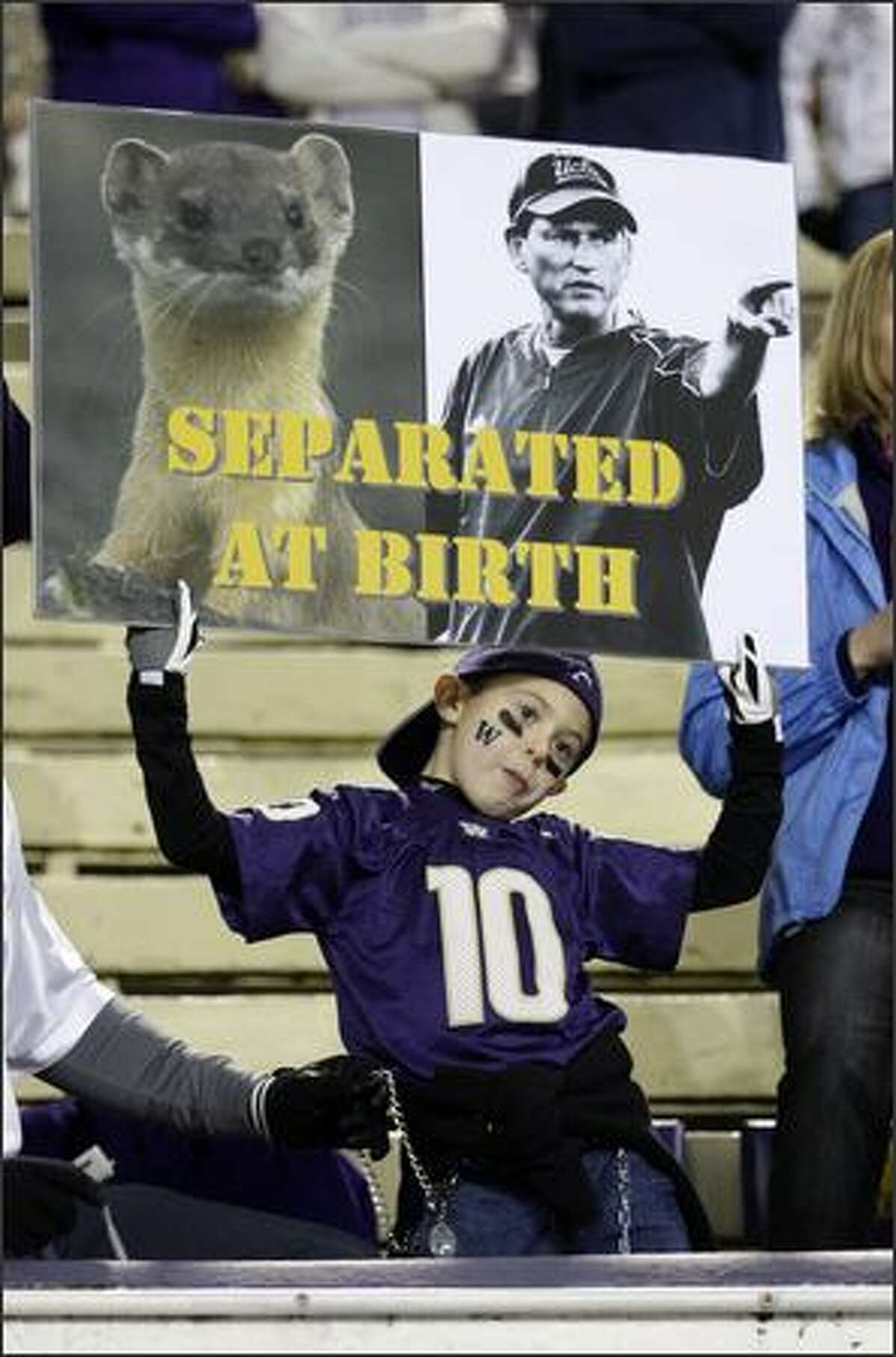 A Washington fan displays his distaste for UCLA head coach and former Washington coach Rick Neuheisel prior to the start of the game at Husky Stadium in Seattle on Saturday.