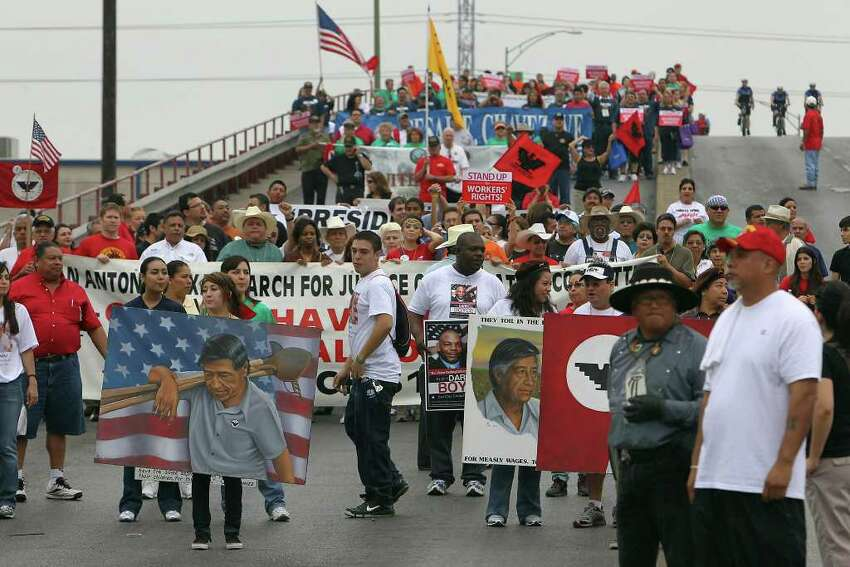 Participants in the Cesar Chavez March for Justice walk over the Guadalupe Street bridge as they make their way toward Alamo Plaza on Saturday, Mar. 26, 2011. This was the 15th year of the event and featured Dolores Huerta, the co-founder of the United Farm Workers of America with famed labor and civil rights leader, Cesar Chavez. According to SAPD Sgt. Fidel Acosta about 1,200 to 1,500 people participated in the march. Kin Man Hui/kmhui@express-news.net