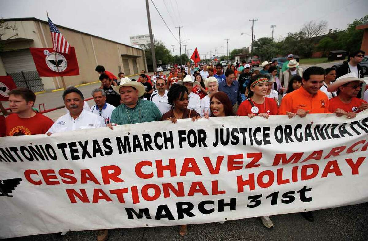 Grand marshal Raulito Navaira (third from front left) joins others carrying a banner to mark the 15th annual Cesar Chavez March for Justice on Saturday, Mar. 26, 2011 as participants made their way along Frio Street. Kin Man Hui/kmhui@express-news.net