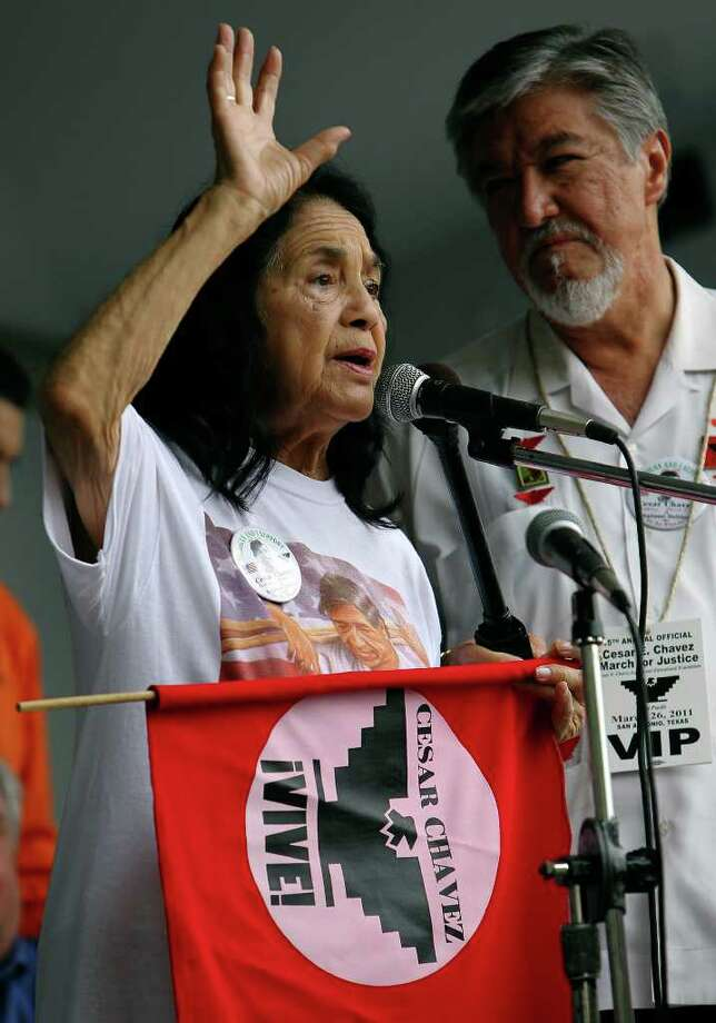 "Co-founder of the United Farm Workers of America Dolores Huerta addresses marchers at the 15th year of the Cesar Chavez March for Justice on Saturday, Mar. 26, 2011. Huerta touched on issues of education and voter rights. ""This march is not an end. This march is a beginning,"" Huerta said. Photo: KIN MAN HUI, Kin Man Hui/kmhui@express-news.net / San Antonio Express-News NFS"