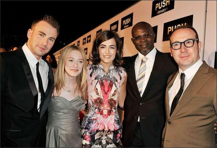 Actors Chris Evans, Dakota Fanning, Camilla Belle, Djimon Hounsou and director Paul McGuigan pose at the premiere of Summit Entertainment's
