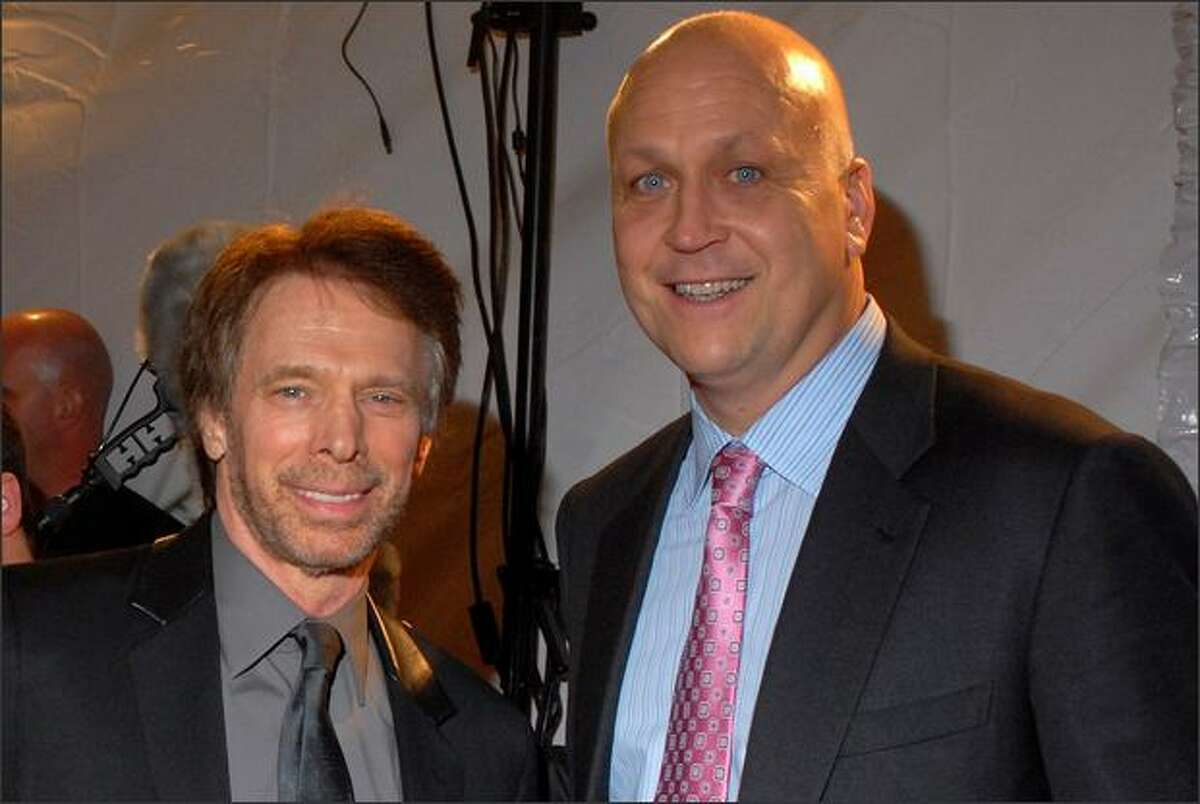 Jerry Bruckheimer and Cal Ripken arrive for the Maxim Magazine Super Bowl XLIII party at The Ritz Ybor on Friday in Tampa, Florida.