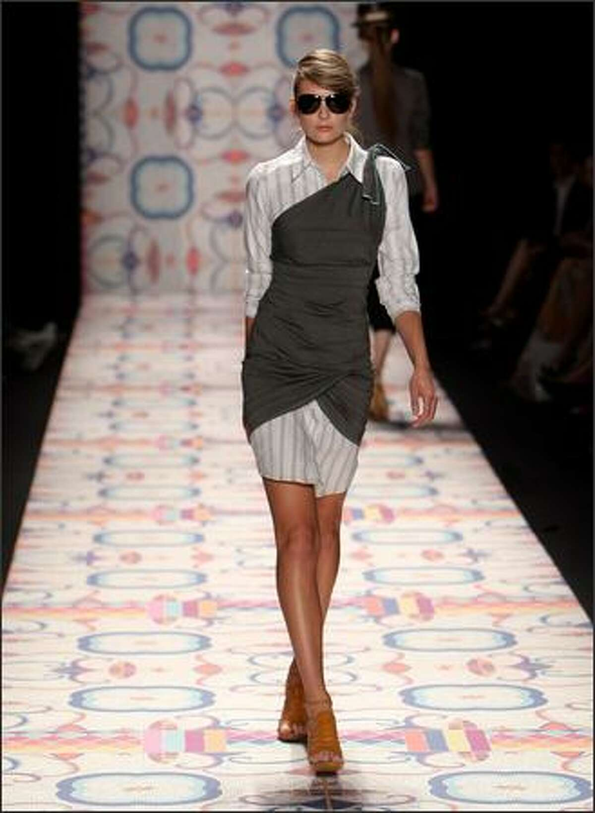 A model walks the runway at the Nicole Miller show.