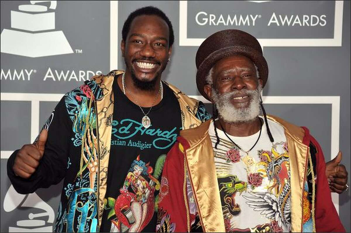 Singer/musicians Selwyn Brown and Winston Rodney of Burning Spear arrive.