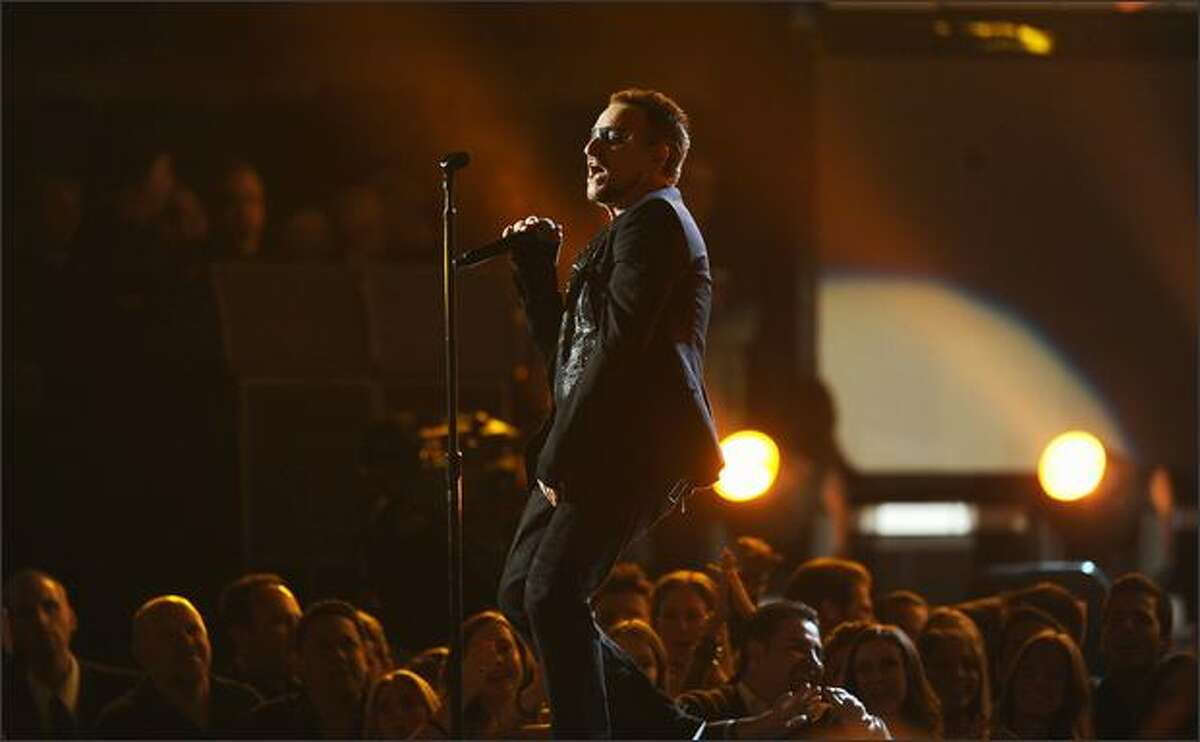 Bono of U2 performs during the opening of the 51st annual Grammy Awards held at the Staples Center in Los Angeles on Sunday, Feb. 8, 2009.