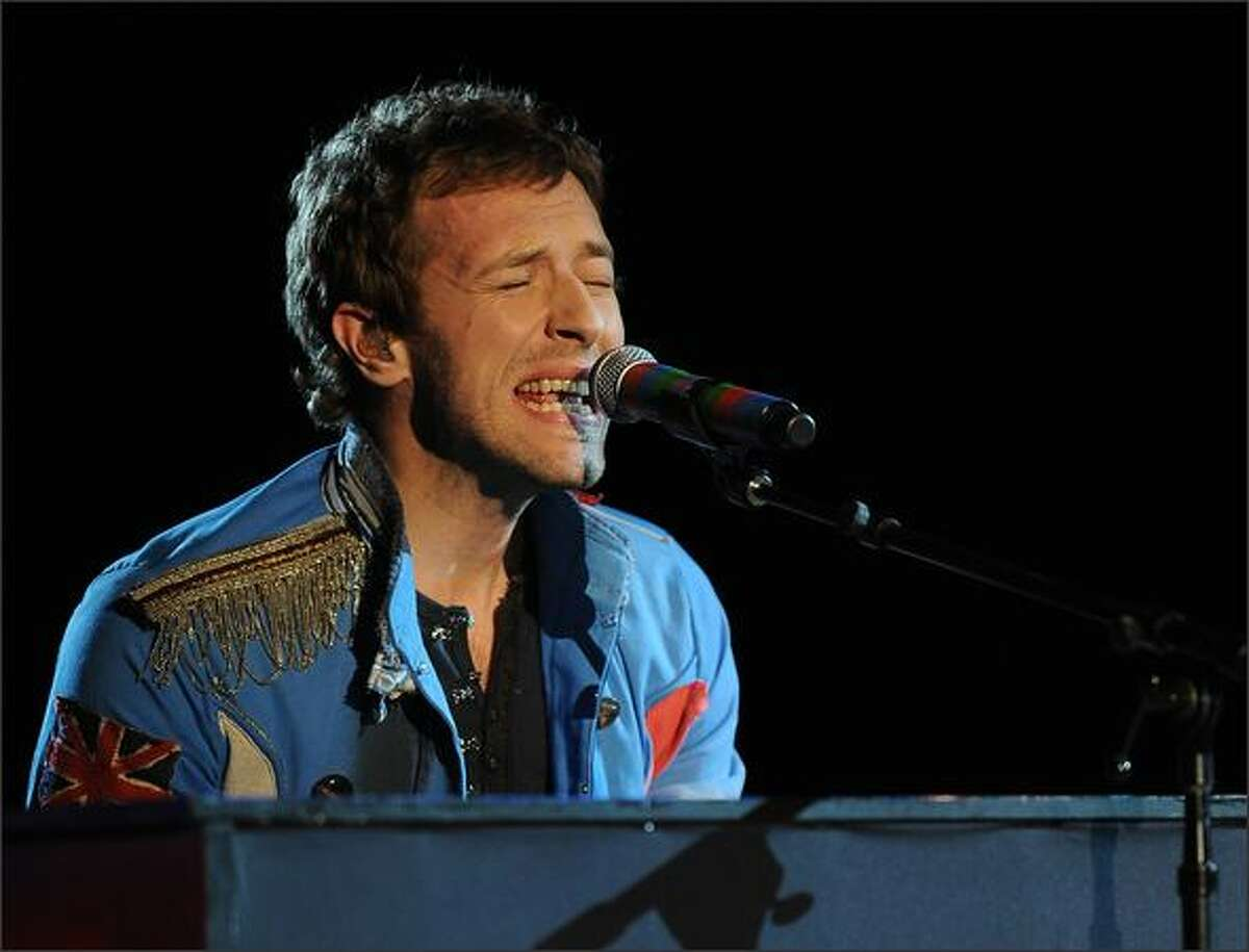 Chris Martin and his band Coldplay perform.