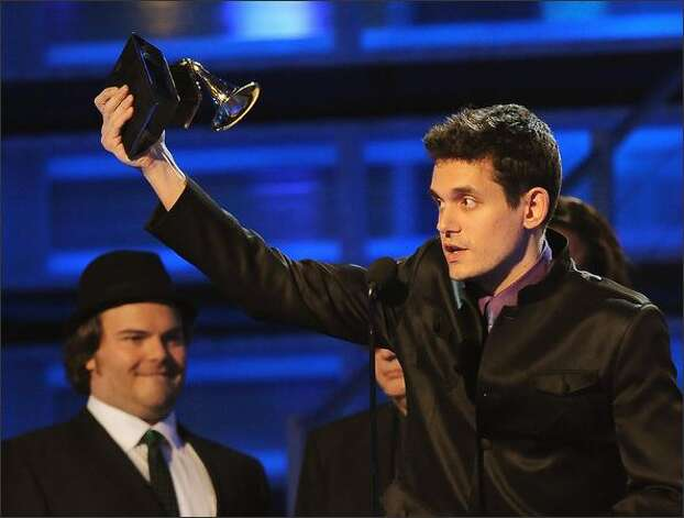 John Mayer salutes the audience after receiving the award for Best Male Pop Vocal Performance. Photo: Getty Images