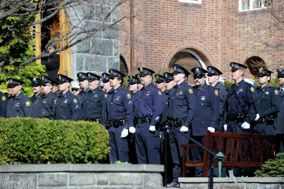 Greenwich police at the funeral service for fellow Greenwich Police Officer James Genovese at St. Mary Church, Greenwich, Saturday, March 26, 2011.