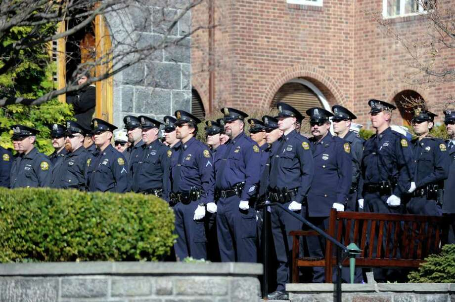 Greenwich police at the funeral service for fellow Greenwich Police Officer James Genovese at St. Mary Church, Greenwich, Saturday, March 26, 2011. Photo: Bob Luckey / Greenwich Time