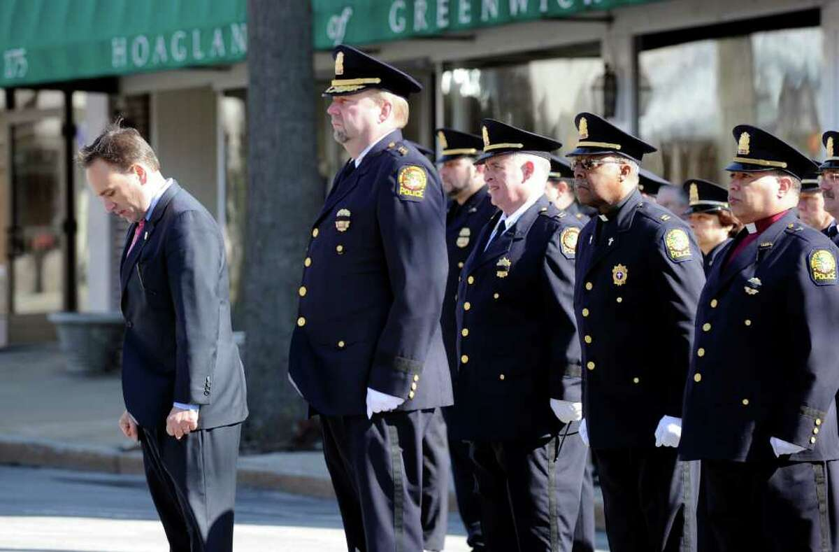 Greenwich First Selectman Peter Tesei, left, bows his head during the funeral service for Greenwich Police Officer James Genovese at St. Mary Church, Greenwich, Saturday, March 26, 2011. At center of photo is Greenwich Police Chief David Ridberg.