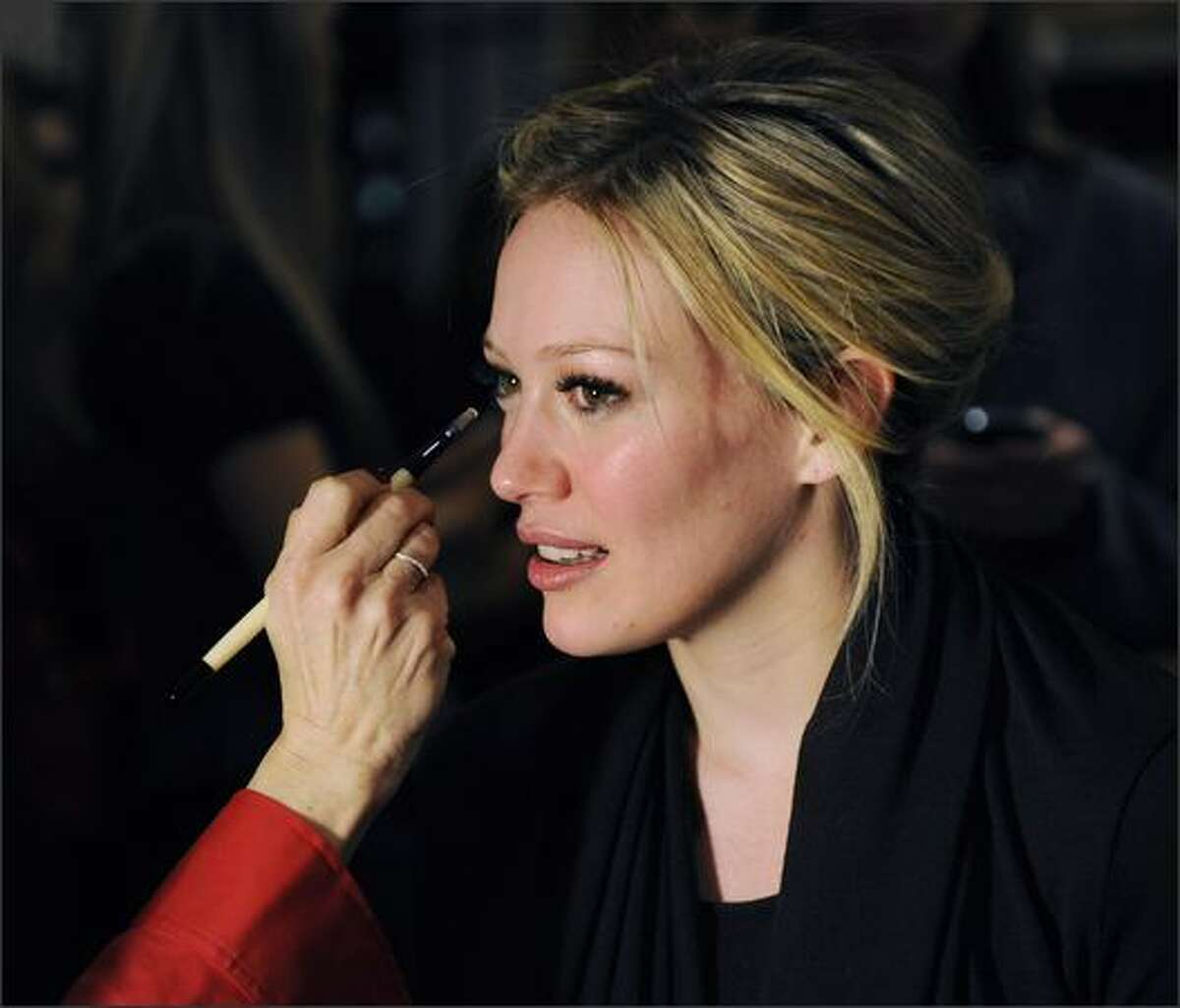 Singer Hilary Duff gets ready backstage before the Heart Truth Red Dress Collection 2009 Fashion Show at the Mercedes Benz Fashion Week in New York.