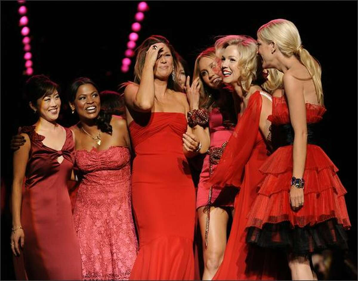 Celebrity Models gather at the end of the show during the Heart Truth Red Dress Collection 2009 Fashion Show at the Mercedes Benz Fashion Week in New York.
