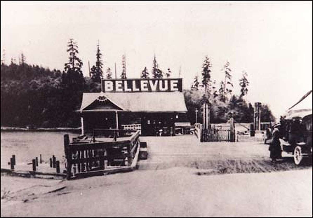 From the P-I archives: A sign towers over the Bellevue ferry dock in the early part of the century. The small car ferries that crossed Lake Washington between Leschi, Medina and Meydenbauer Bay were suspended after the first Interstate 90 floating bridge was built in 1946.