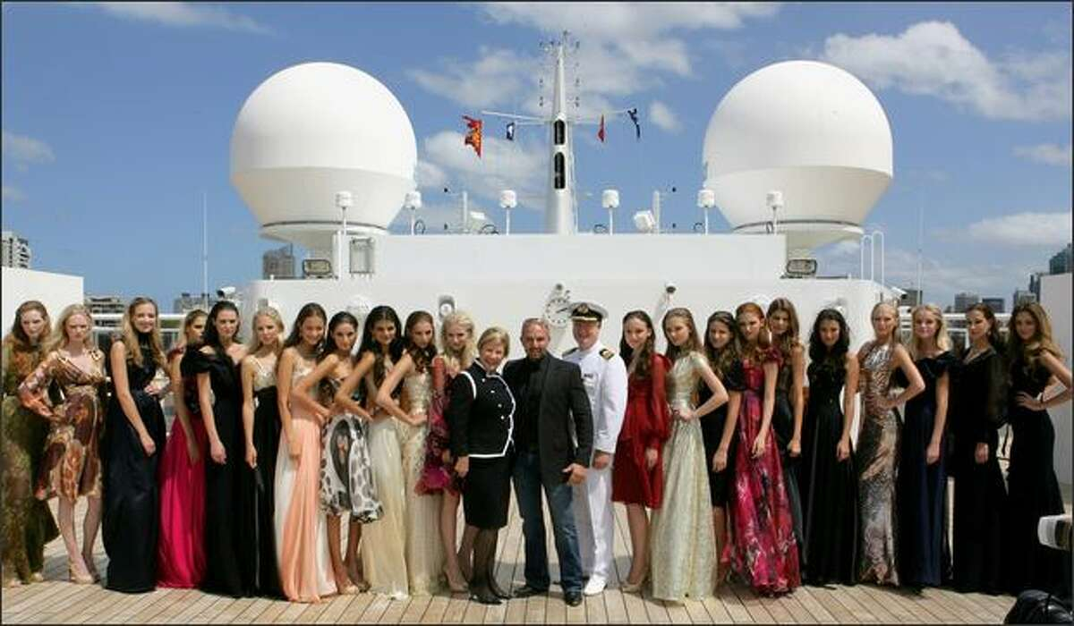 Alex Perry with models and Queen Mary 2 Hotel Manager on the Queen Mary 2 on Thursday in Sydney, Australia.