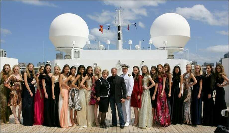Alex Perry with models and Queen Mary 2 Hotel Manager on the Queen Mary 2 on Thursday in Sydney, Australia. Photo: Getty Images