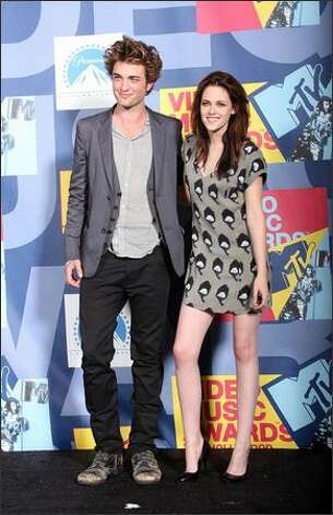 Here's Pattinson in 2008 with Stewart at the MTV Video Music Awards. Still looks about the same, right? (Getty Images) Photo: Getty Images