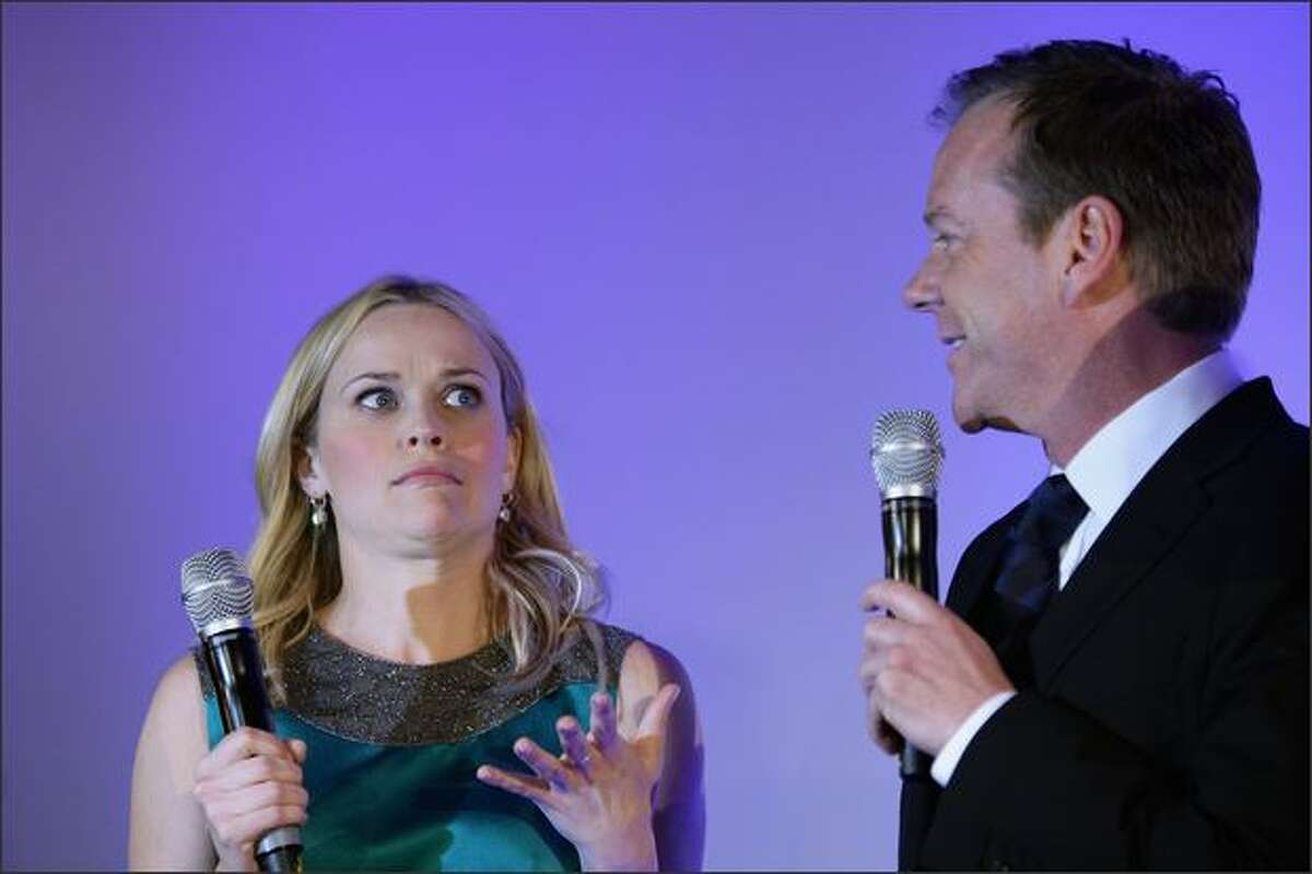 Actress Reese Witherspoon and actor Kiefer Sutherland attend the 'Monsters Vs. Aliens' German Premiere at the Colosseum in Berlin, Germany.