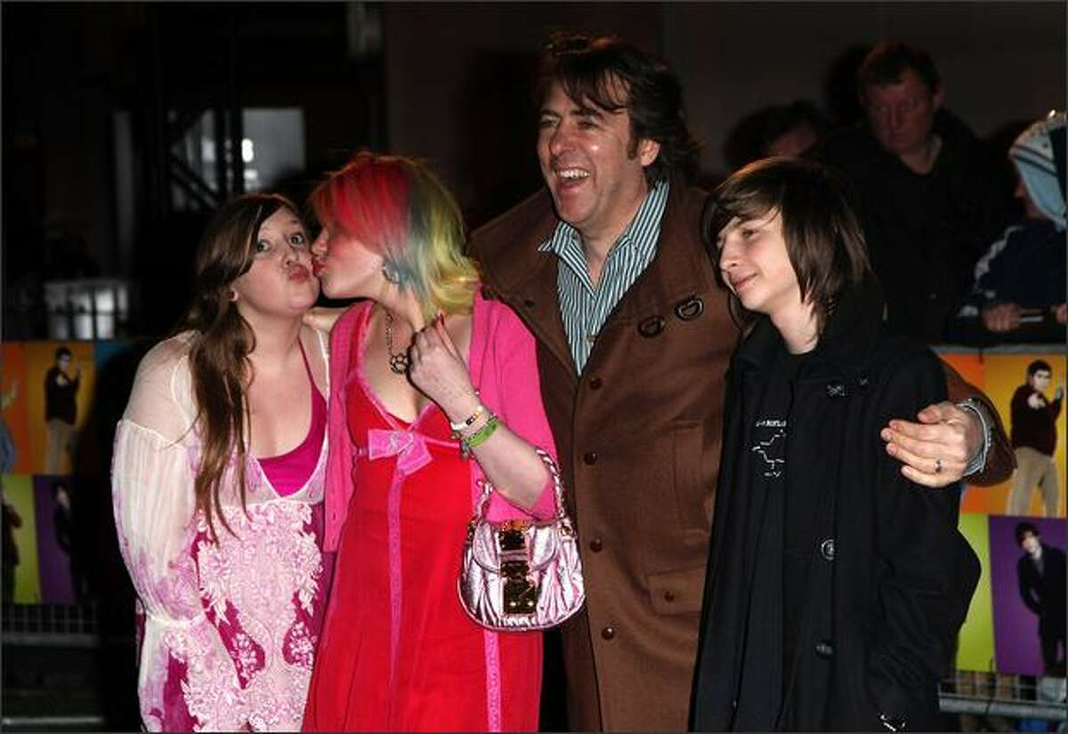 Jonathan Ross and kids Honey Kinny, Betty Kitten and Harvey Kirby arrives at the World Premiere of 'The Boat That Rocked' held at The Odeon, Leicester Square in London, England.