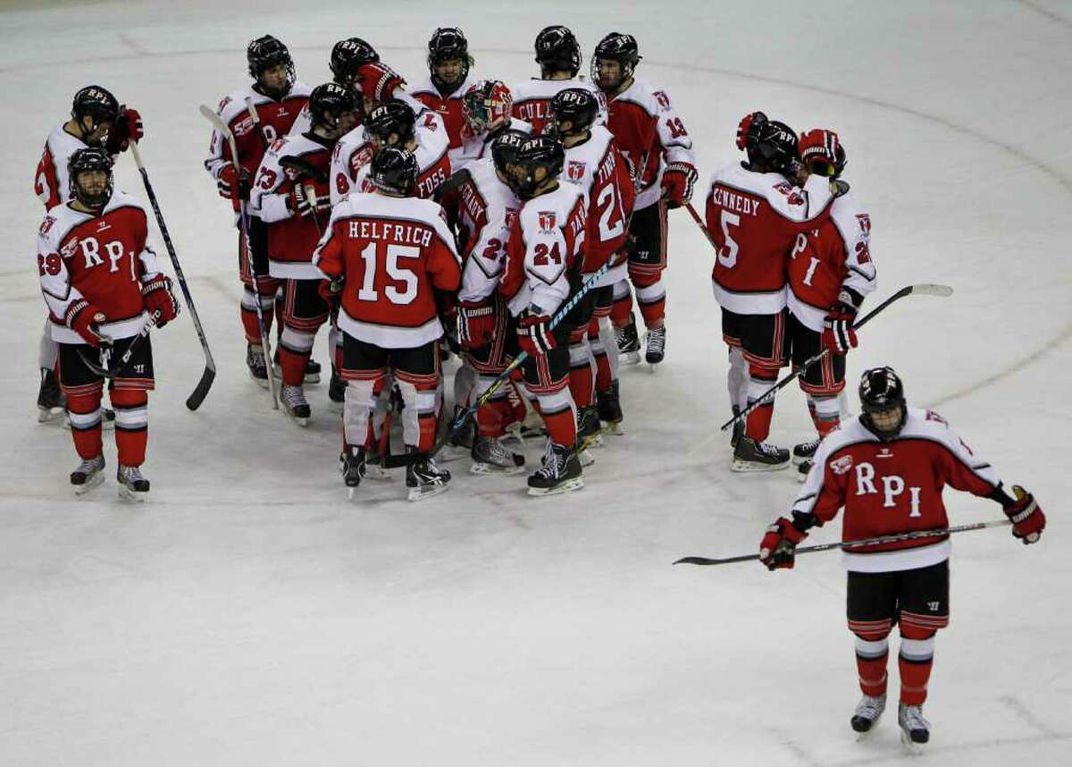 Rensselaer's gathers near their goal after losing to North Dakota 6-0 Saturday March 26, 2011 at the Resch Center in Green Bay, Wis. during the first round of the NCAA Division I Men's Ice Hockey Midwest Regional. (Photo by Mike Roemer)