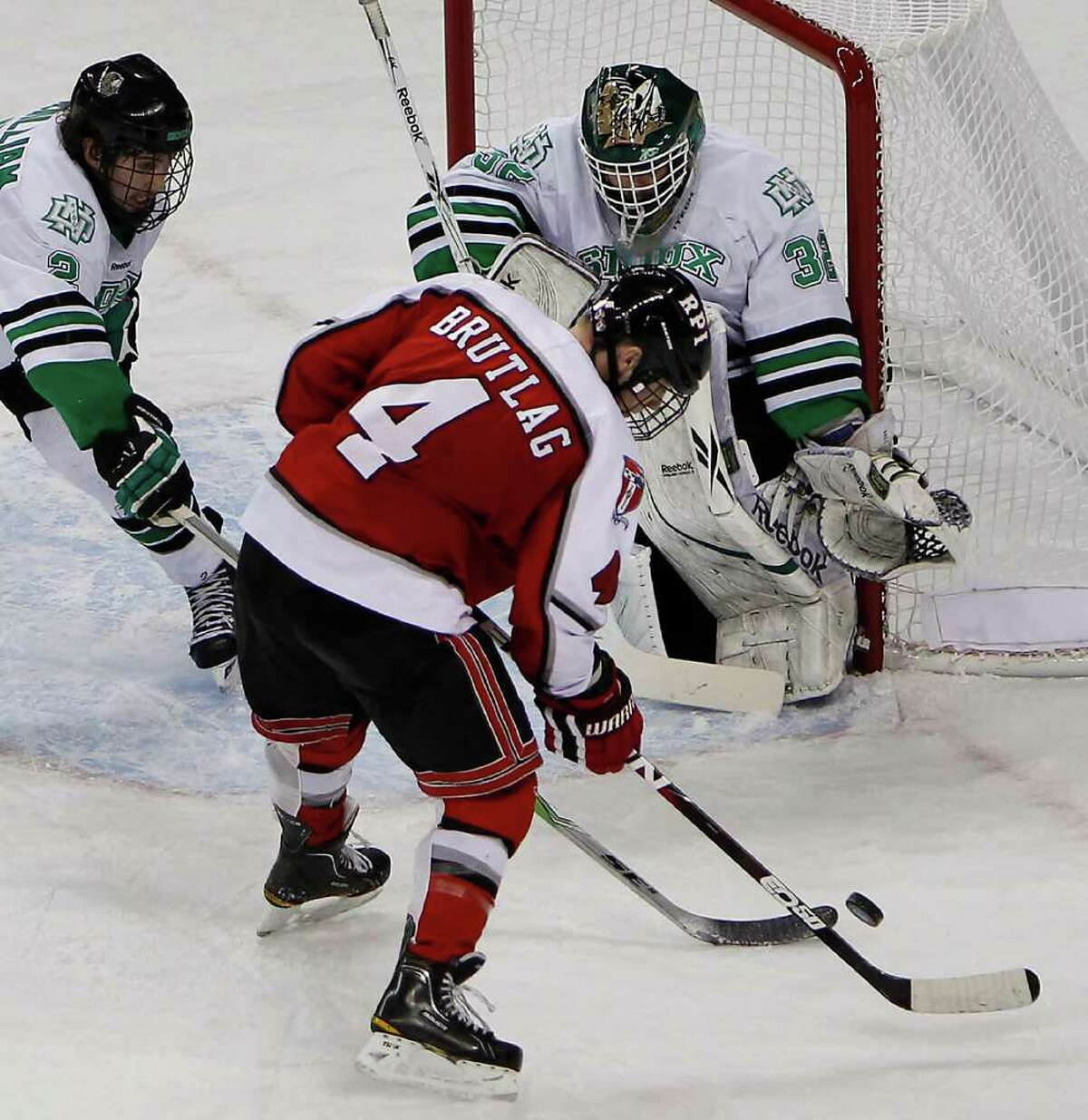 NorthDakota's goalie Aaron Dell get ready for a shot by Rensselaer's Bryan Brutlag Saturday March 26, 2011 at the Resch Center in Green Bay, Wis. during the first round of the NCAA Division I Men's Ice Hockey Midwest Regional. Rensselaer lost 6-0.(Photo by Mike Roemer)