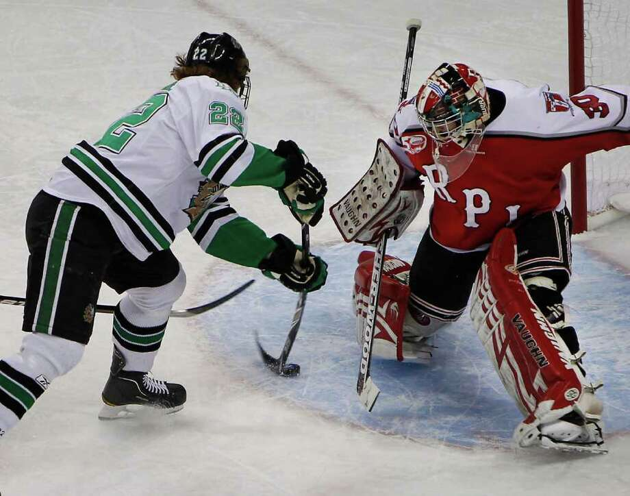 NorthDakota's Brad Malone scores on Rensselaer's goalie Allen York Saturday March 26, 2011 at the Resch Center in Green Bay, Wis. during the first perior of the first round of the NCAA Division I Men's Ice Hockey Midwest Regional. (Photo by Mike Roemer) Photo: Mike Roemer