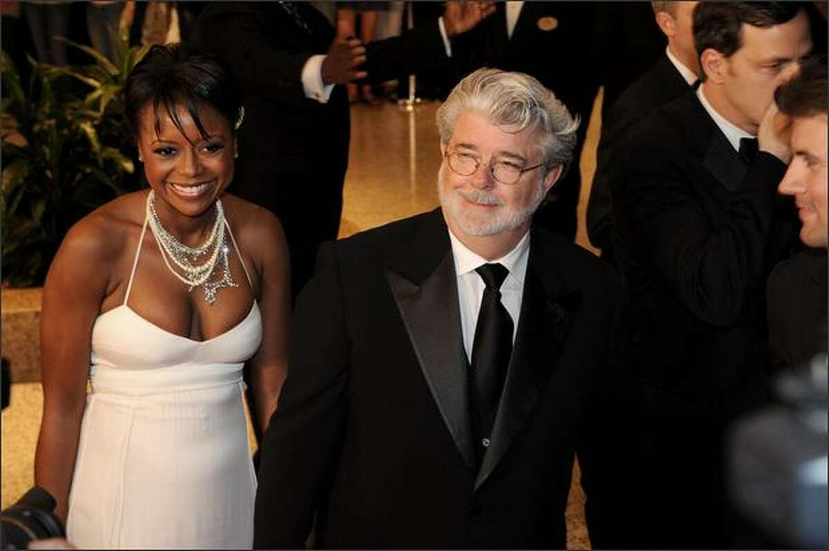 Film direcor George Lucas arrives for the 2009 White House Correspondents' Dinner with his girlfriend Mellody Hobson on Saturday, May 9, 2009 at the Washington Hilton in Washington.