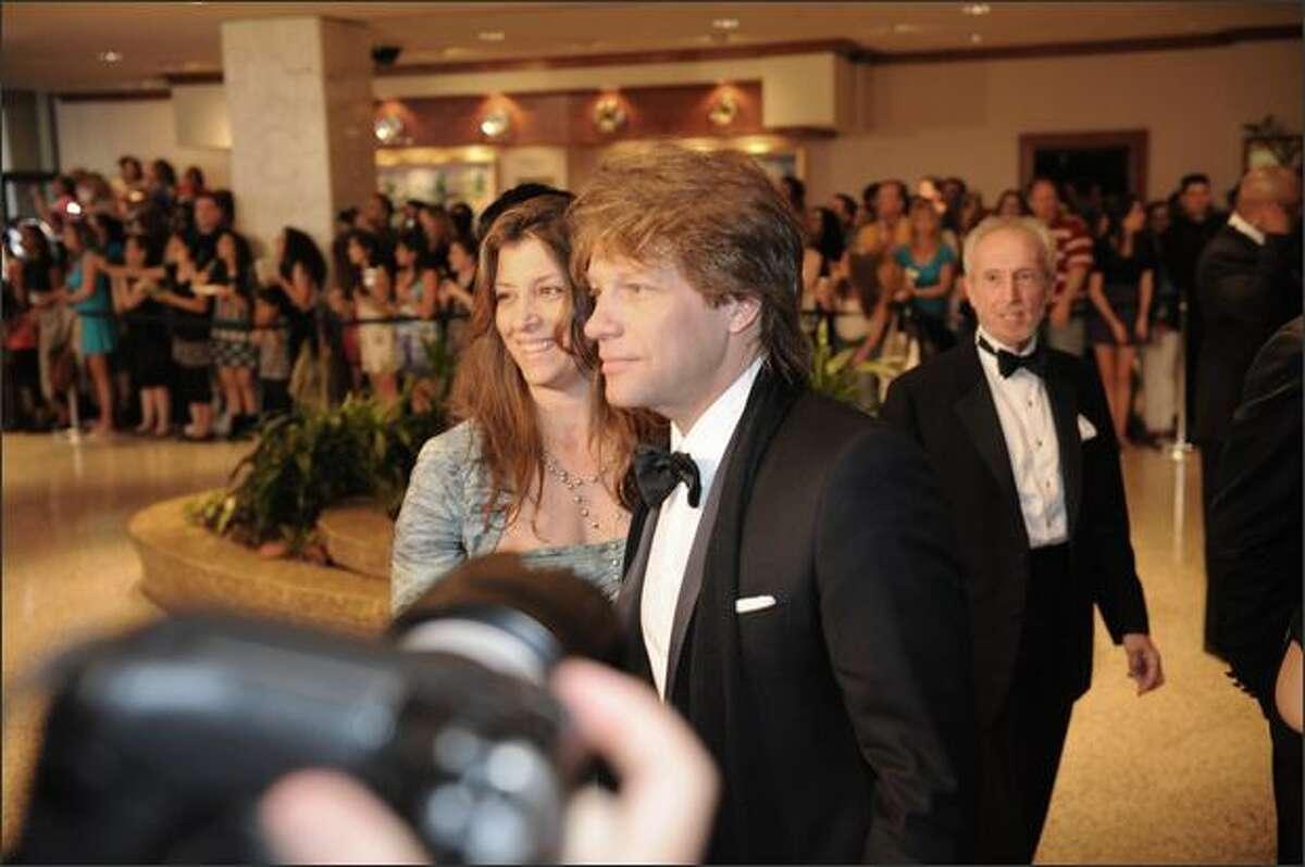 Rock star Jon Bon Jovi and his wive Dorothea arrive.