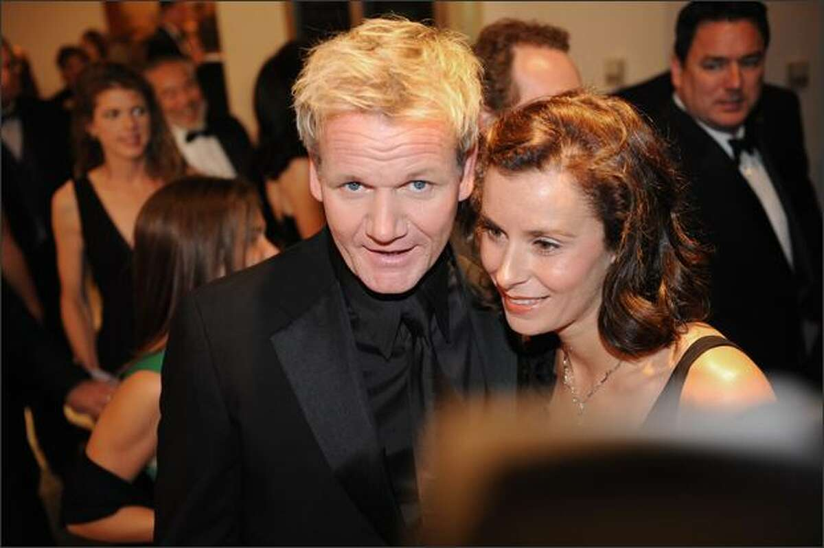 Reality television personality and British celebrity chef Gordon Ramsay arrives with his wife Tana.