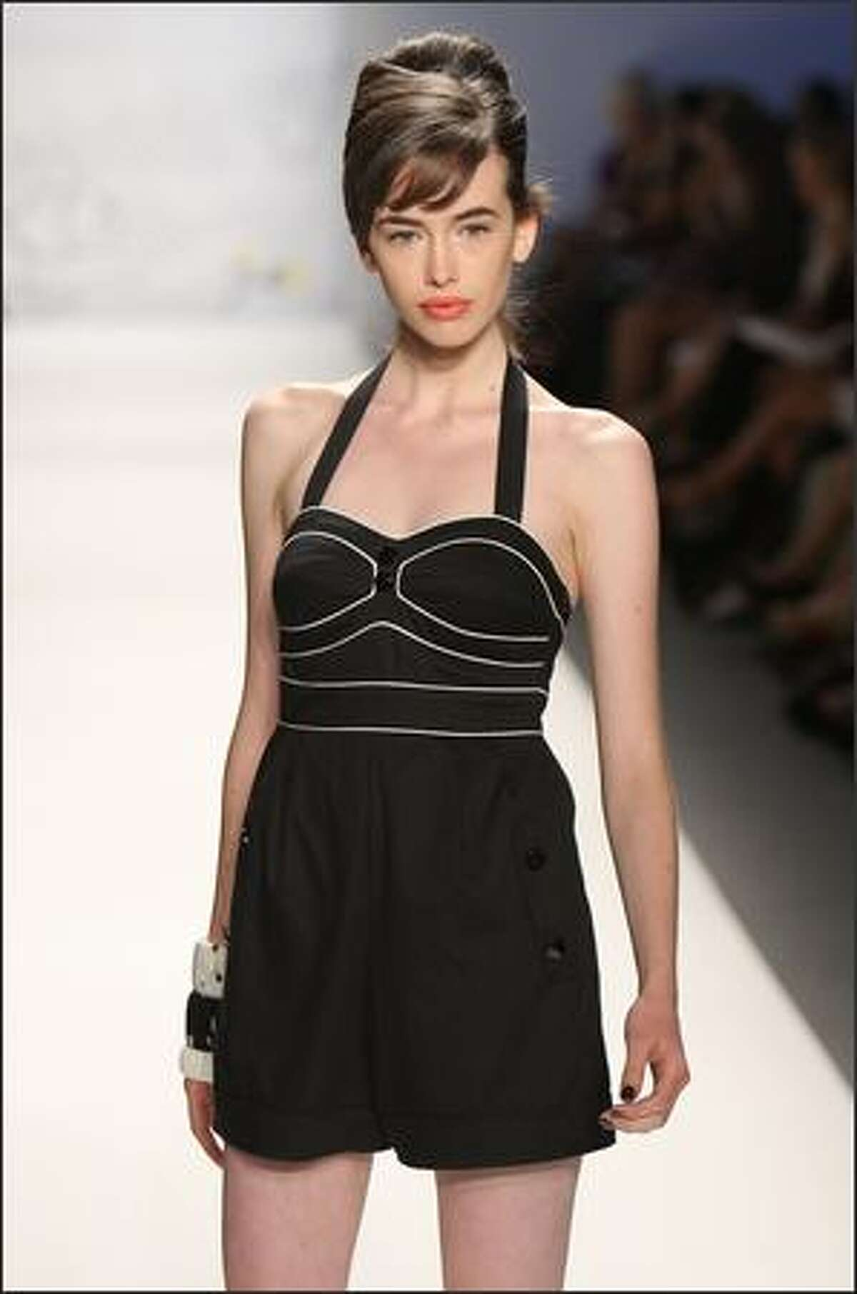 A model walks the runway at the Twinkle By Wenlan Spring 2009 fashion show during Mercedes-Benz Fashion Week at The Salon, Bryant Park, on Monday in New York City.